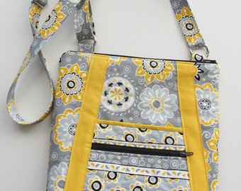 Quilted Crossbody purse, with stylish pockets, and an adjustable strap. Yellow, Grey, & Black Flowers