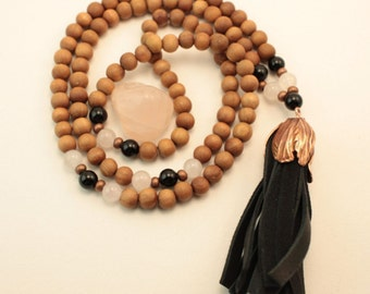 Fragrant Indian Sandalwood, Rose Quartz, Onyx 108 bead mala with rose gold/copper accents and soft deer leather tassel.