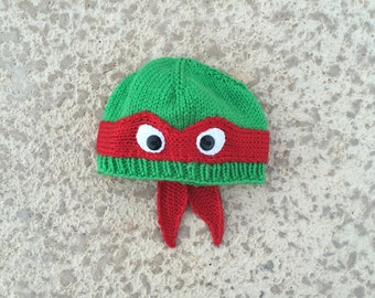 Adult XL Raphael: Hand-knit teenage Raphael mutant ninja turtle hat with ribbed bottom edge.  COWABUNGA!