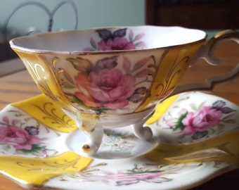 Three footed lusterware tea cup, adorable.