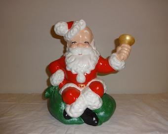 Hand painted ceramic Santa ringing bell