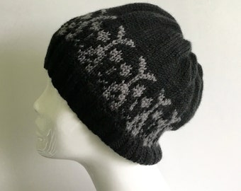 Hand knit black skull hat, black wool beanie, black wool hat with skulls.