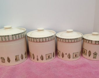 PORTFOLIO by PFALTZGRAFF NATUREWOOD is a Vintage Graduating Set of 4 Lidded Cream Stoneware Canisters Decorated in Soft Greens and Browns