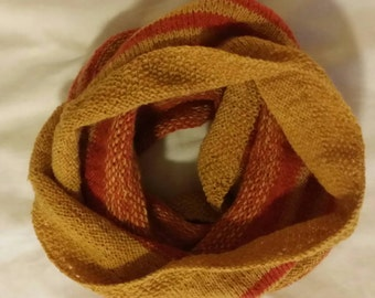 Handknitted cowl in yellow and orange