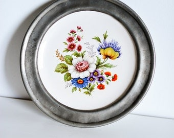 A lovely French pewter-rimmed collectors' plate