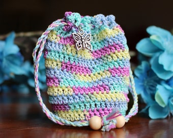 Small crochet pouch with drawstrings, multicolor, cotton thread, butterfly charm, wooden beads