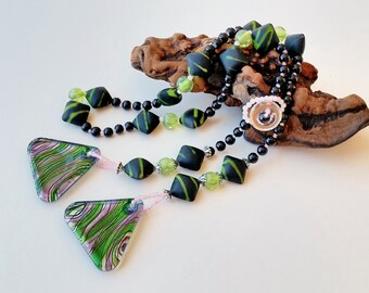 "Lariat Wrap Necklace: 28"" pink/green/black beaded lariat, lampwork glass triangular pendants and vintage button & loop. Sundance boutique."