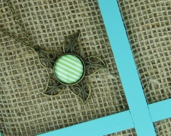 Pinwheel glass pendant antique bronze necklace