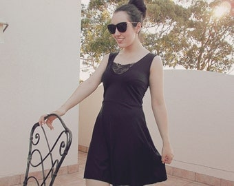 Black A line skater dress with lace insert