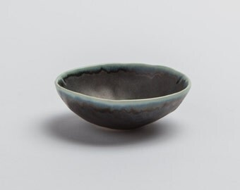 Porcelain Pinch pot with Gunmetal glaze and moon white accent on rim