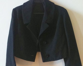 Short black 70's jacket.
