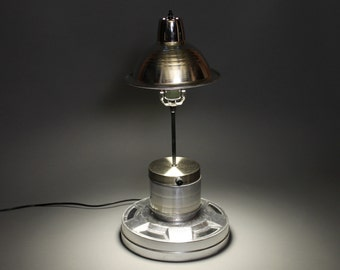 Upcycled wheel cover and other vintage pieces in this cool and functional lamp