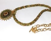 Handcrafted Kumihimo green and gold rope necklace with Gold plated chain and bead Embroidered Swarovski Pendant.