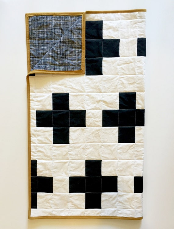 black and white plus sign baby quilt gold by wilderandbean