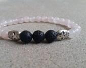 Vegan Friendly Rose Quartz and Lava Rock Healing Crystal Aromatherapy stretch bracelet with Skulls. Bohemian, Hippie Bracelet. Heart Chakra