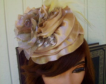 Fascinator (F600) Royal Ascot, Derby Races Hat, Satin Ruffles, Ivory Feathers, Organza Roses, Silver Coils, Swarovski Crystals