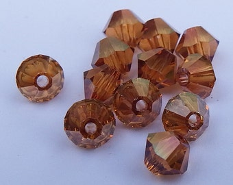 Close Out!  Crystal Copper Swarvoski Crystal, 4 mm, Bi-Cone, Pkg of 12, 5328 or 5301