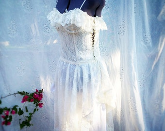 Upcycled boho wedding dress with vintage lace and lace up side