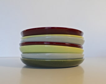 A Set of Seven Mid-Century Ceramic Salad Plates Made by Brusché/Bauer Pottery of California