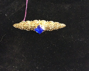 Gold and created sapphire brooch