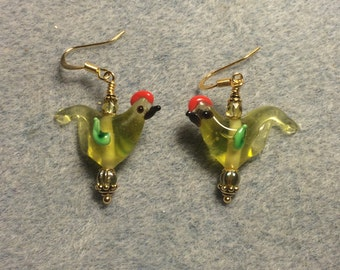 Translucent yellow green red crested lampwork songbird bead dangle earrings adorned with yellow green Czech glass beads.