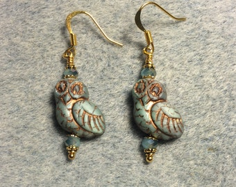 Blue with copper wash fancy owl bead earrings adorned with blue Chinese crystal beads.