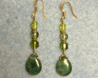 Olive green Czech glass briolette earrings adorned with light olive green Czech glass beads.