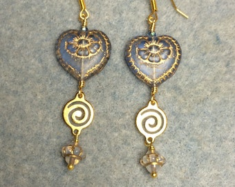 Light blue with gold inlay Czech glass heart bead dangle earrings adorned with gold swirly links and light blue Saturn beads.