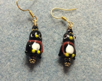 Black and white lampwork penguin earrings adorned with black Chinese crystal beads.