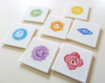 Glass coasters with traditional chakra symbol designs, set of 7, made from white fused glass