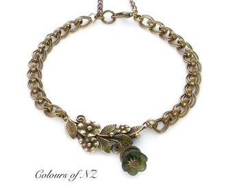 Antiqued Brass Chain Bracelet With Embossed Floral Link And Dainty Lucite Deep Olivine Bell Drop