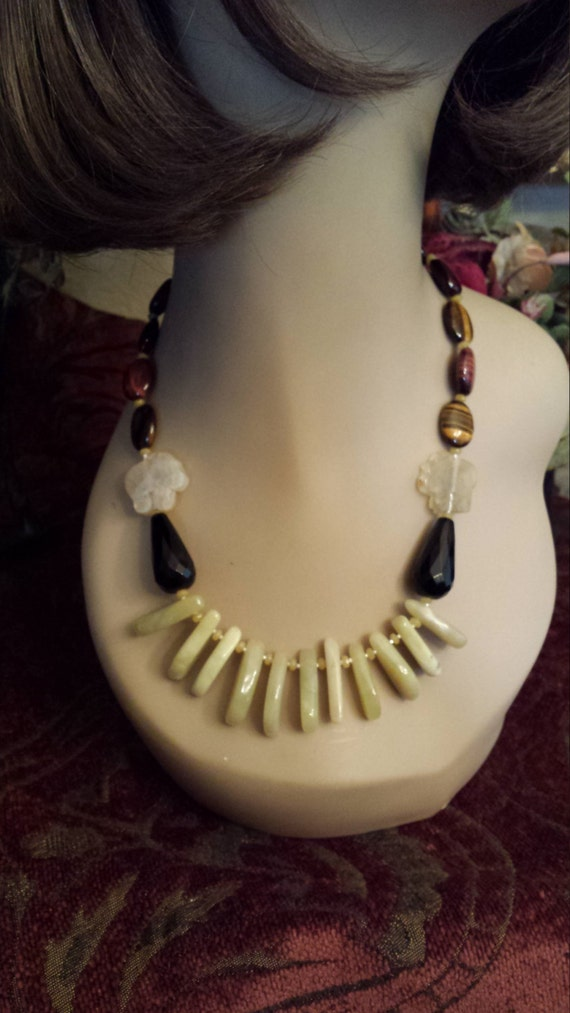 One strand beaded necklace made with faceted black onyx, tiger eye, jasper and green teardrop jade