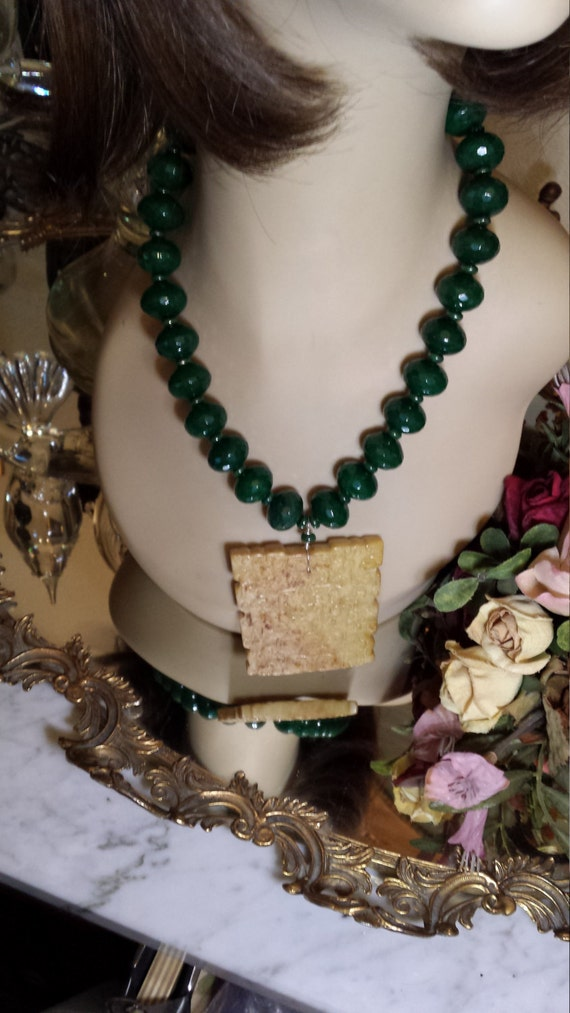 Large faceted jade beaded necklace with jade center drop