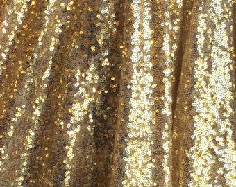 60 inch w shiny gold tiny sequin fabric