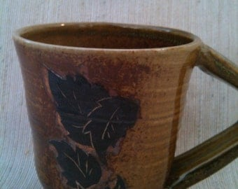 Woodfire cup with leaves