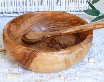 Baby food spoon and bowl of olive wood