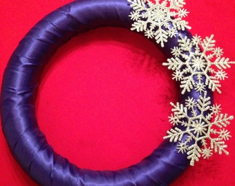 Royal blue ribbon wreath with silver snowflakes