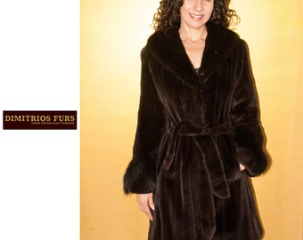 Knee length hi-lo fitted sheared mink coat with belt and fox trimmed sleeves