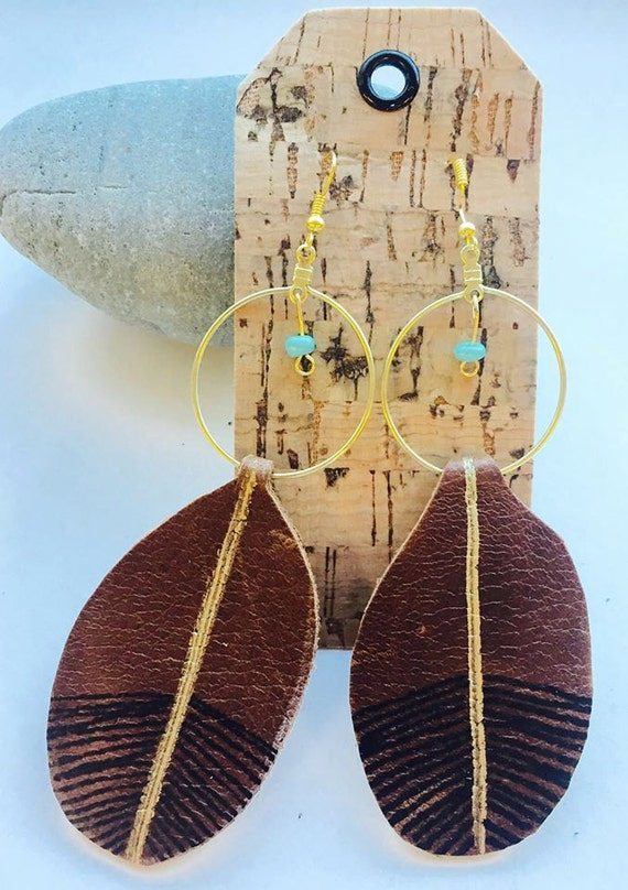 Rounded leather painted earrings with bead accent