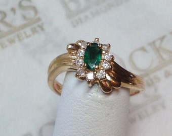 Vintage 14k yellow gold Ribbed Bypass Ring Oval Emerald and 10 Diamonds in a Halo .31 tw I-I1-2, size 6.25
