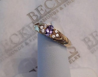 Vintage 14k yellow gold Oval Tanzanite & 6 Cubic Zirconia (CZ) Ring .20 ct, size 7.25