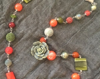Green and coral red necklace