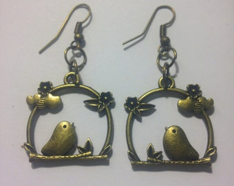 Birds on a swing drop earrings in bronze finish
