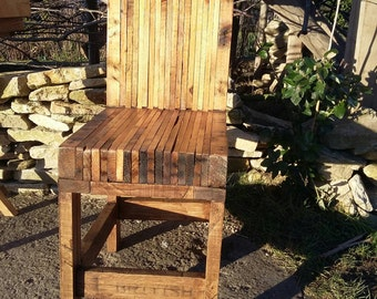 Trendy, romantic desk chair (dining room chair) with a vintage look completely made of reclaimed pallet wood.
