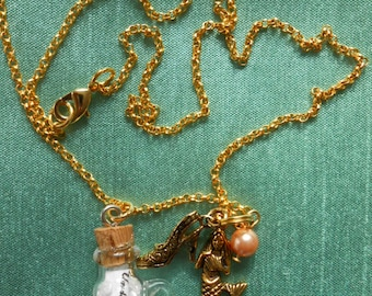 the Little Mermaid with a bottle necklace