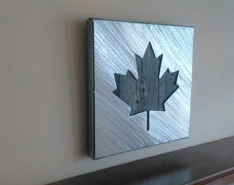 Scrap metal Canadian Maple leaf and Reclaimed Barn wood picture hanging