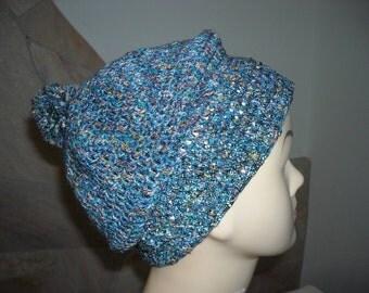 Women's beret with pom poms.