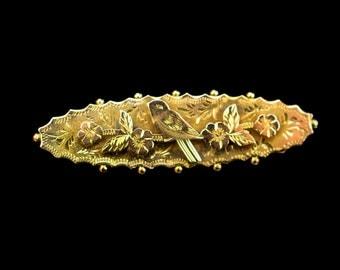 A Pretty Antique Victorian Bird Brooch. 9 Carat Gold.
