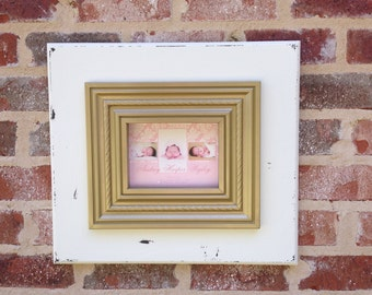 White and gold 5x7 picture frame.
