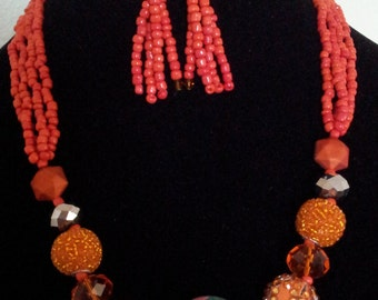 red necklace with earrings